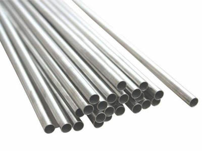 several galvanized round posts are bulk stored on the white background
