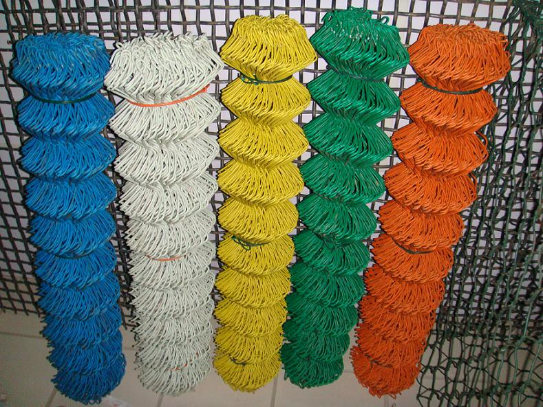 There are five shrink volumes of chain link fence in different colors.