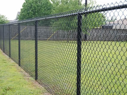 Several pieces of chain link fencings are installed on the grassland.