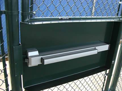 A powder coated chain link fence gate with panic bar.