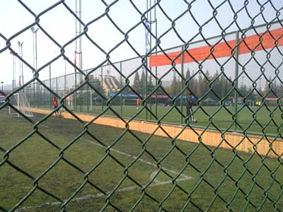 There is green PVC coated chain link fence for football field fencing.