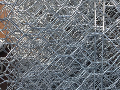 There are many pieces of zinc coated hexagonal wire mesh netting.