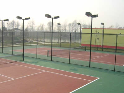 There is green chain link fence for tennis court fencing.